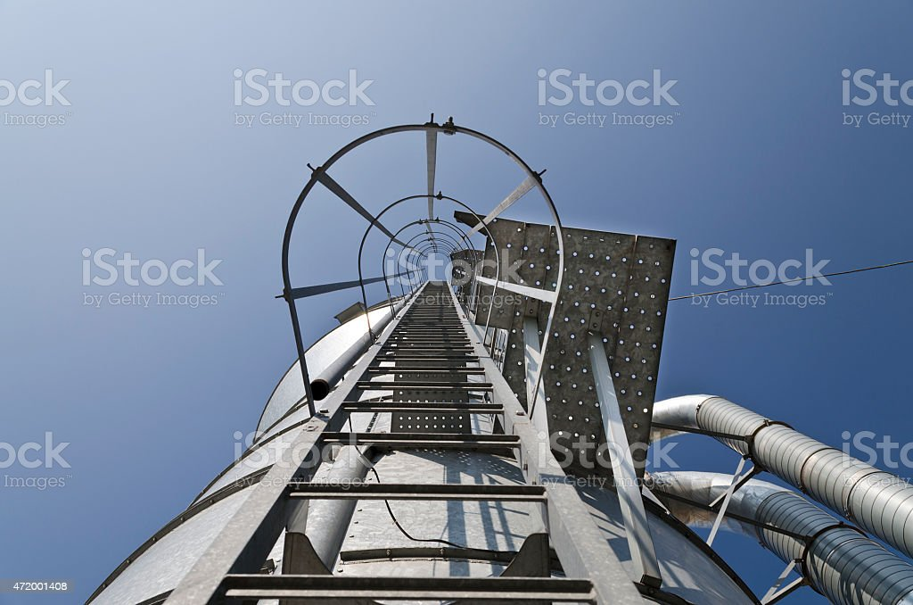 Personal perspective to the Safety metal ladder stock photo