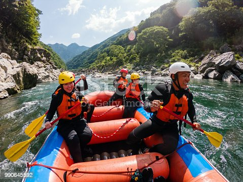 Personal point of view of a group of men and women while white water river rafting