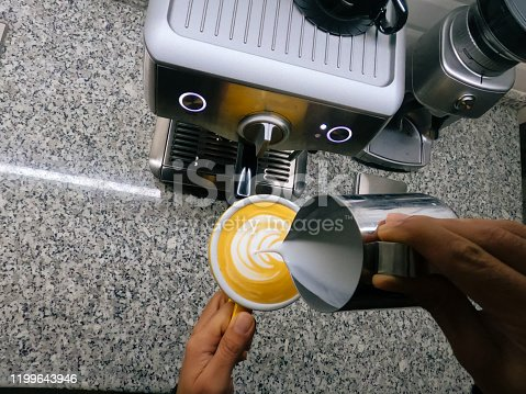 Personal point of view of barista pouring making cappuccino