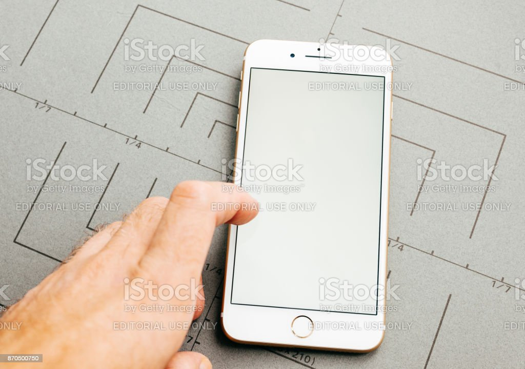 Personal prespective of  white display, on iPhone 7 Plus the application software stock photo
