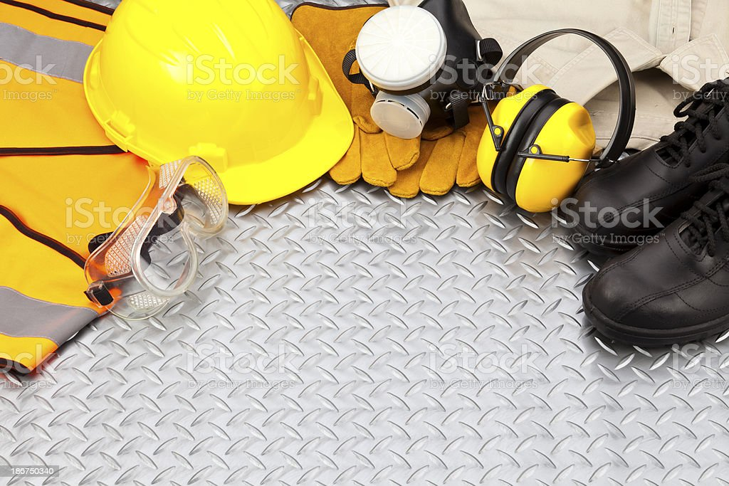 Personal protective workwear border on diamondplate background stock photo