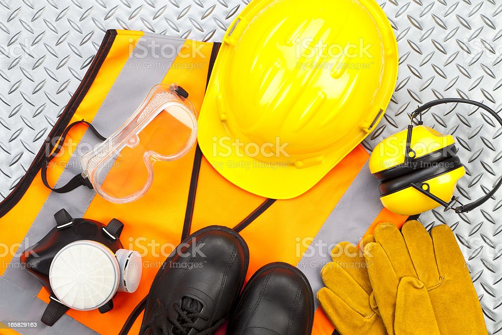 Personal protective workwear shoot from above on diamondplate background stock photo