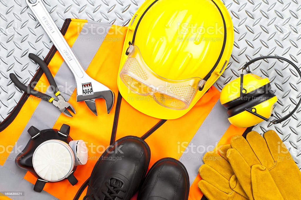 Personal protective workwear shoot from above on diamondplate stock photo