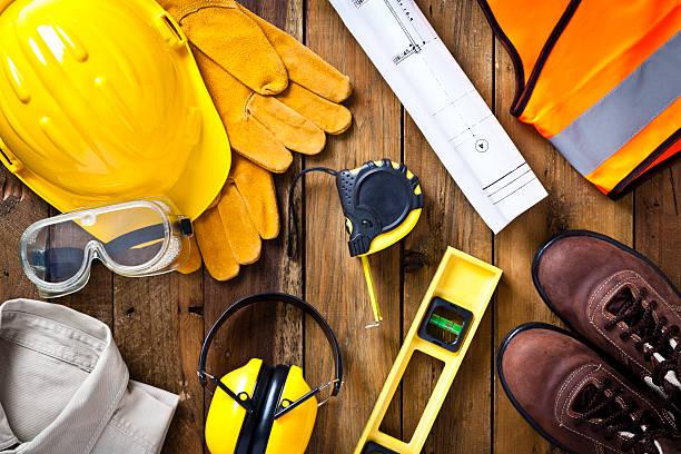 bezpieczeństwo osobiste ubrań roboczych i budownictwa projekt zdjęcia bezpośrednio powyżej - kask ochronny odzież ochronna zdjęcia i obrazy z banku zdjęć
