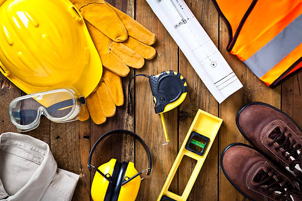 personal safety workwear and construction blueprint shot directly above - safety stock pictures, royalty-free photos & images