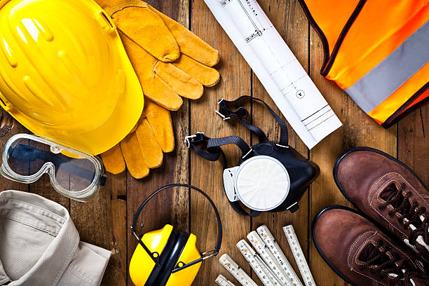 personal safety workwear and construction blueprint shot directly above - protective workwear stock pictures, royalty-free photos & images