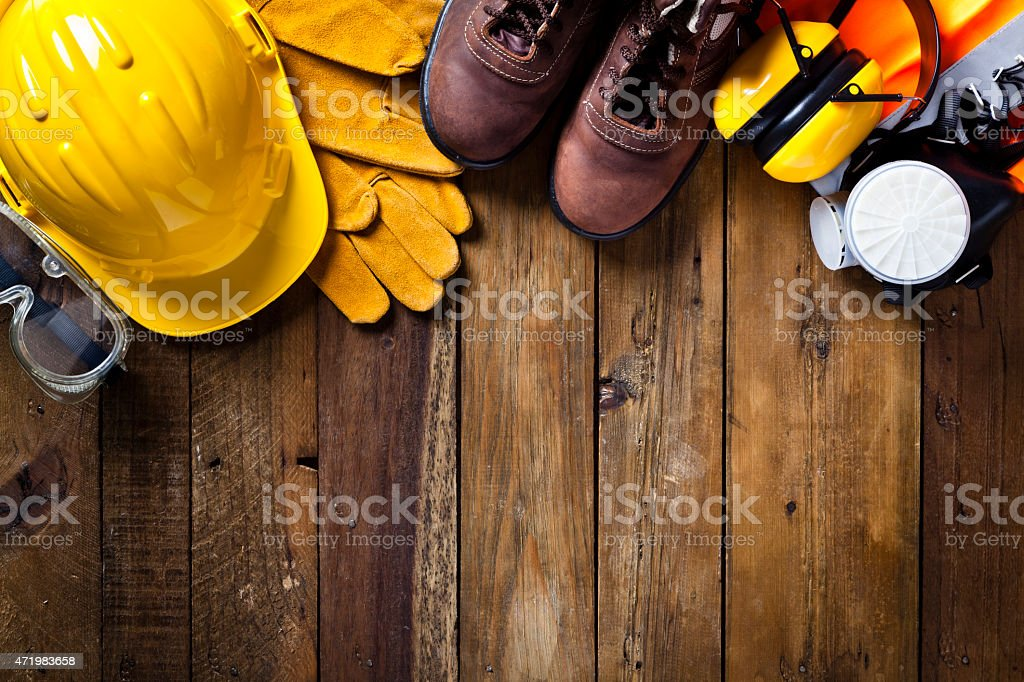Personal safety workwear border on rustic wood background stock photo