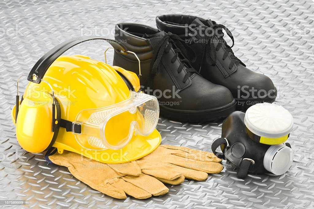 Personal safety workwear on diamond plate background stock photo