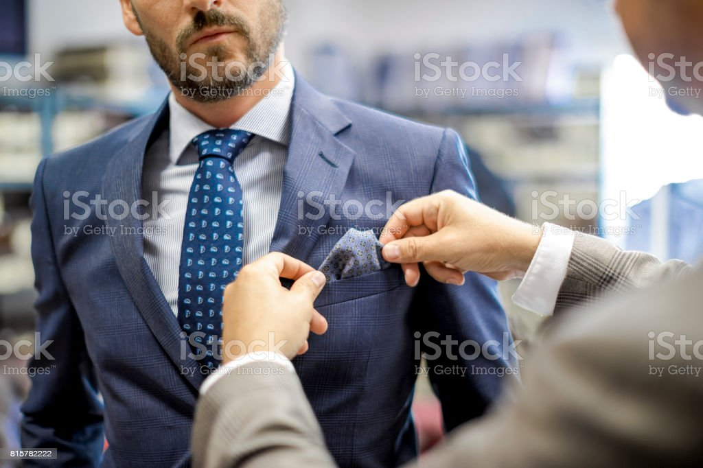 A personal stylist helping his customer stock photo