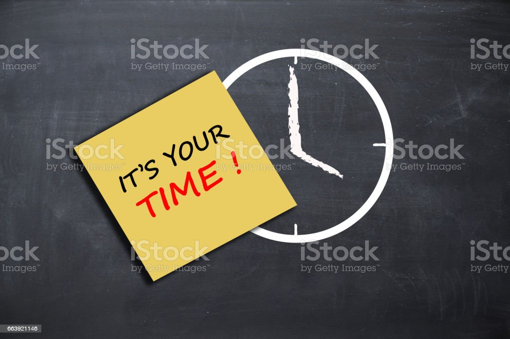 """Personal success concept with """"it's your time"""" text on post-it and alarm clock drawn on chalkboard stock photo"""