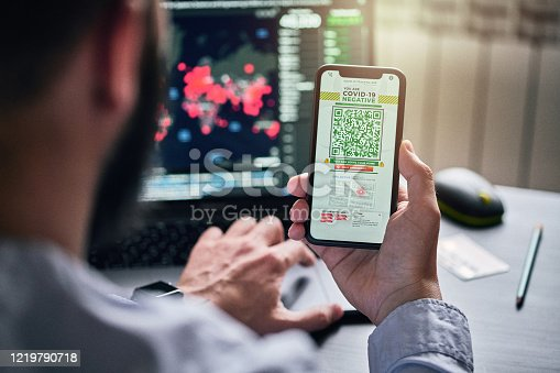 istock Personal tracking App with QR code on a smart phone 1219790718