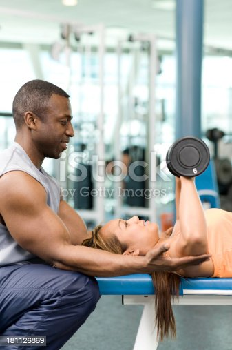 1069872470istockphoto Personal Trainer and Weightlifter 181126869