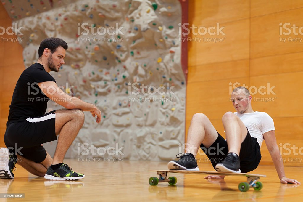 Personal Trainer Assist Workout Young Man royalty-free stock photo