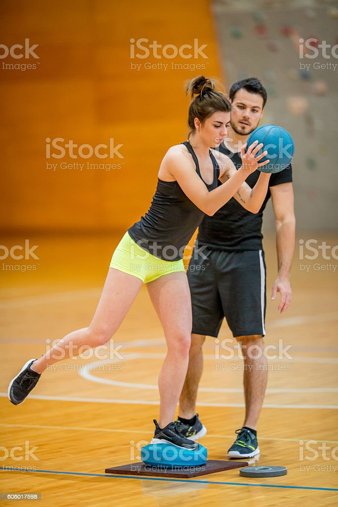 Personal Trainer Checking the Exercise Execution stock photo