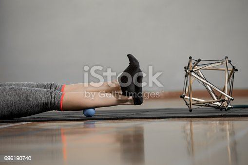 istock Personal Trainer  Demonstrate The Benefits Of Stress Ball Using On Painful Body Part 696190740