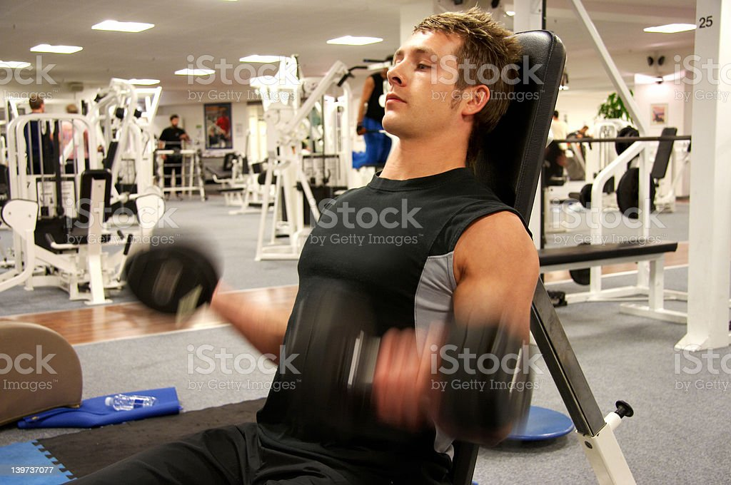 Personal Trainer Doing Biceps Curl royalty-free stock photo