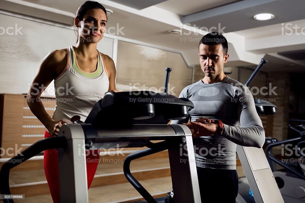 Personal trainer exercise with his client stock photo