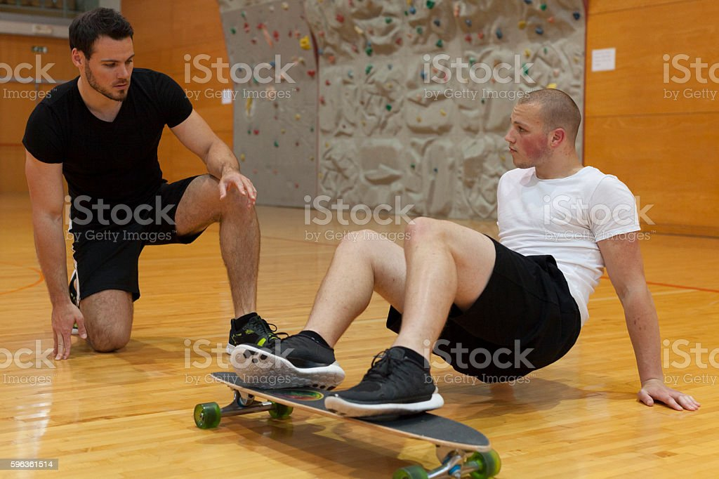 Personal Trainer Explain to Young Man how to Excercise royalty-free stock photo