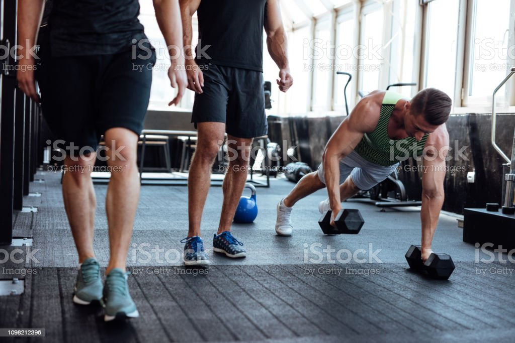 Personal trainer explaining work out exercises to his client