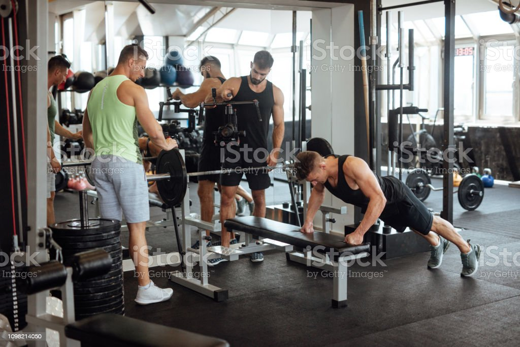 Personal trainer filming work out for social media