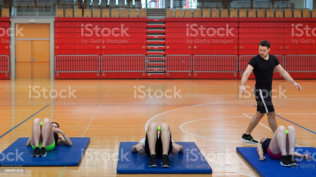 Personal Trainer Follow Exercises of a Group of Young Athletes royalty-free stock photo