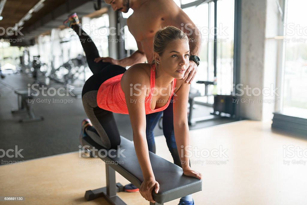 Personal trainer helping stock photo
