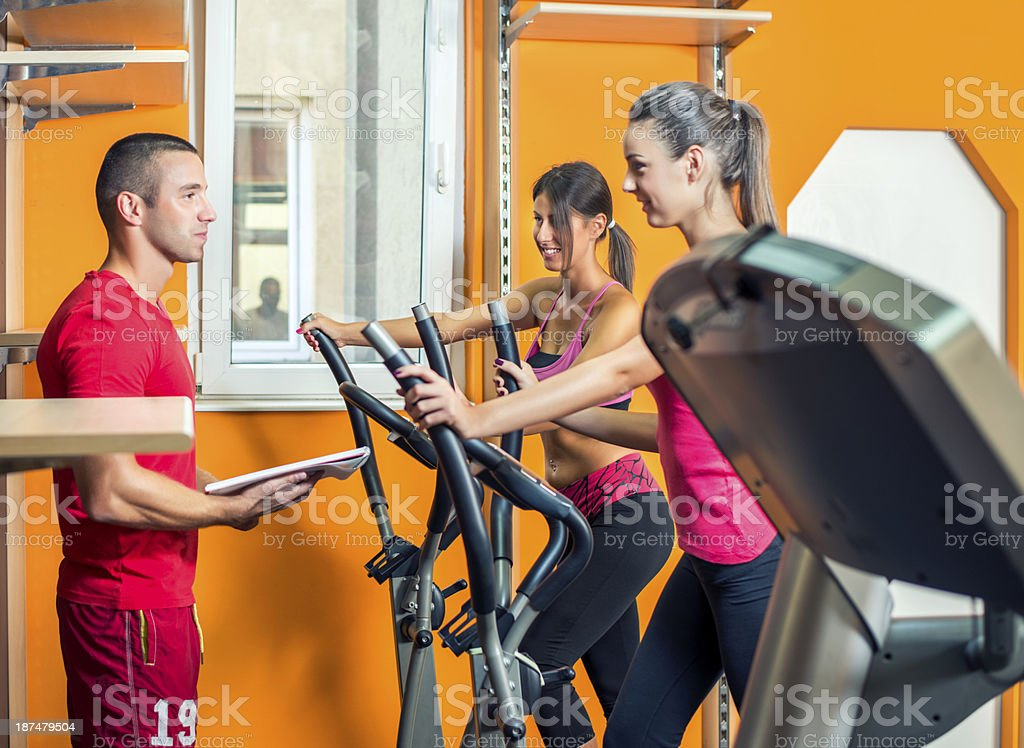 Personal Trainer in gym royalty-free stock photo