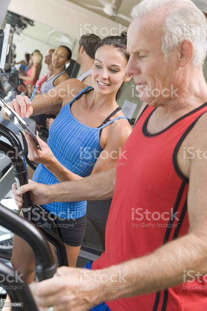 Personal Trainer Instructing Man stock photo