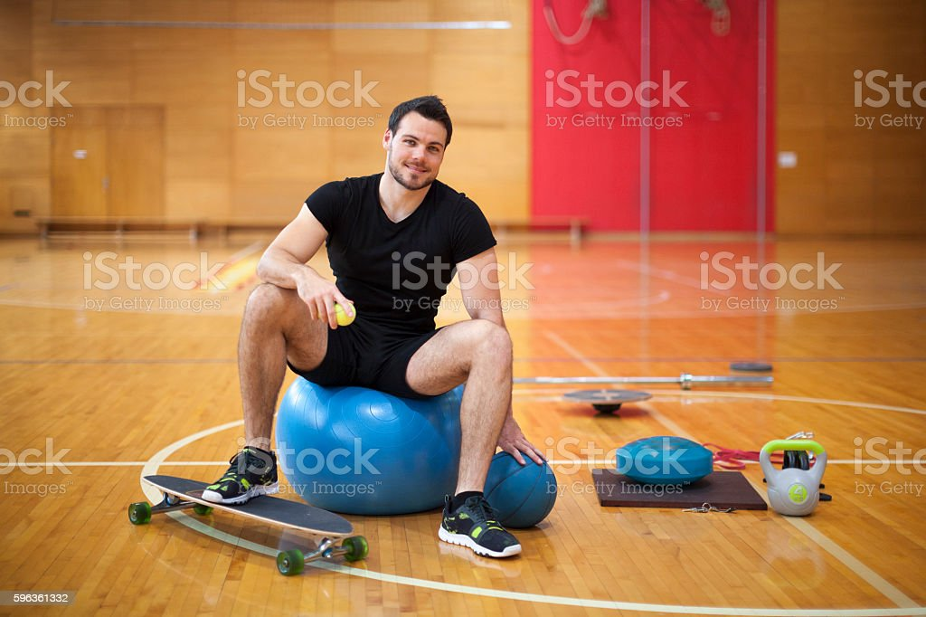Personal Trainer Looking at Camera in Gym royalty-free stock photo