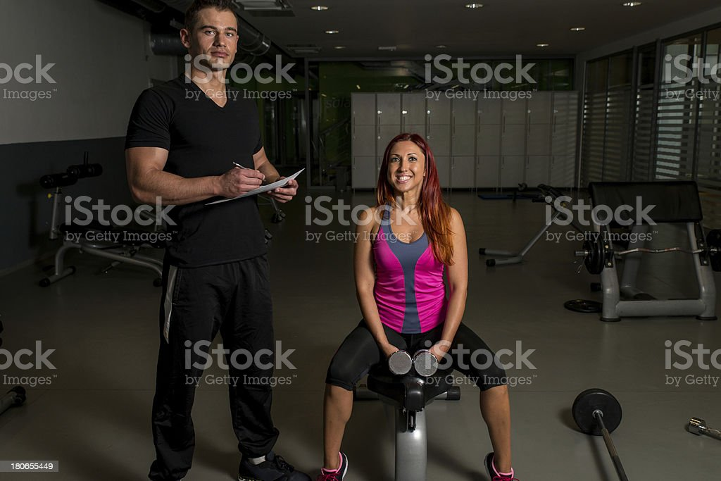 Personal Trainer Take Notes royalty-free stock photo