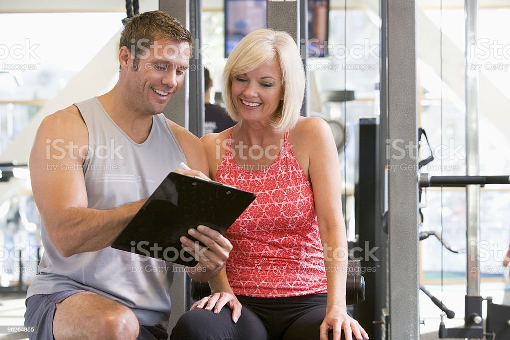 Personal Trainer taking induction with woman stock photo