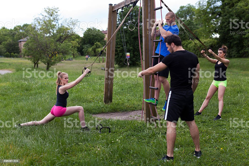 Personal Trainer Teaching Exercises to a Group of Young People royalty-free stock photo