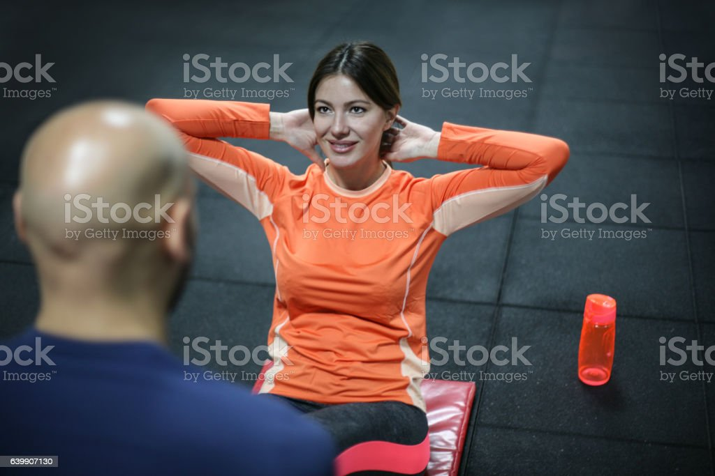 b139bc550b8 Personal Trainer Training His Client In The Gym Stock Photo   More ...