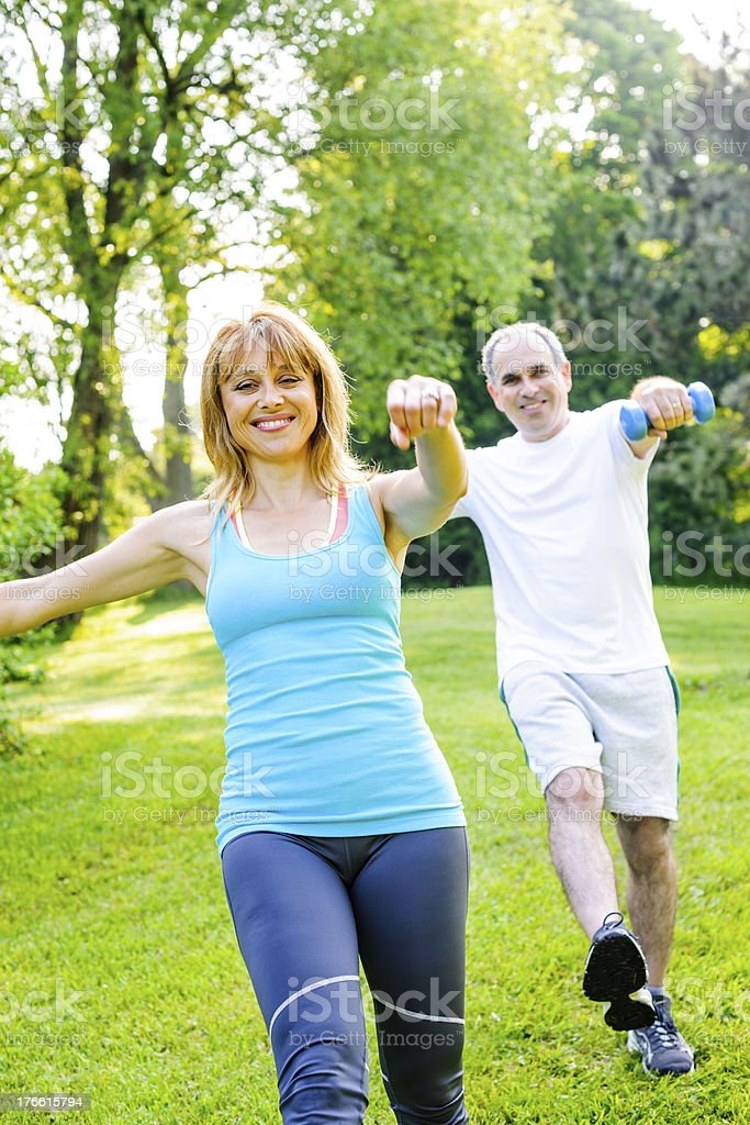 Personal trainer with client exercising in park royalty-free stock photo