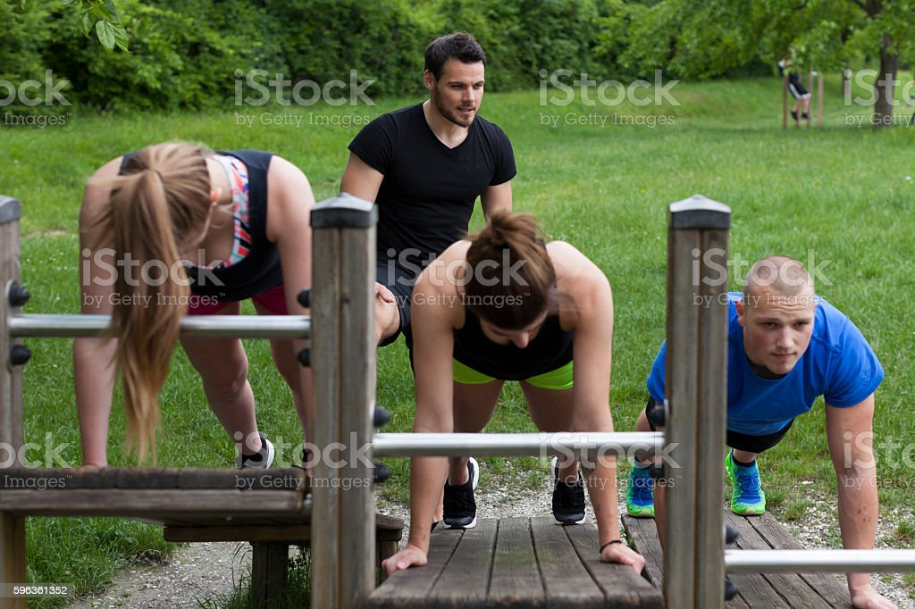 Personal Trainer with Young People Doing Exercises royalty-free stock photo