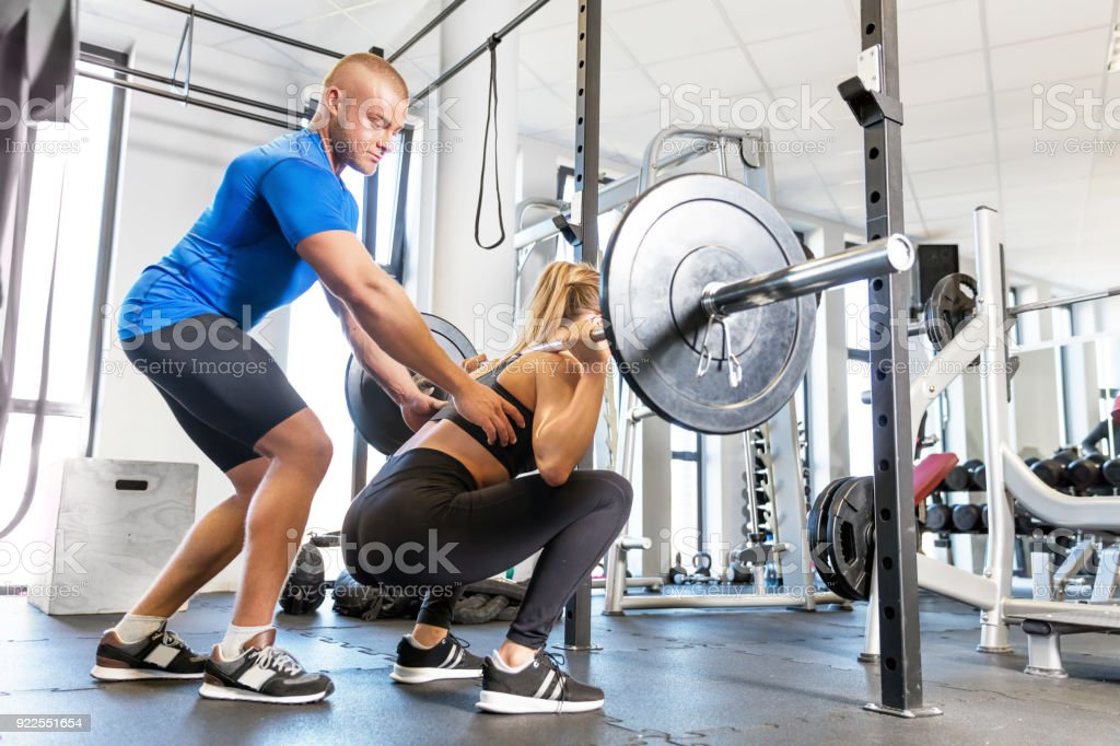 9596514105e Personal trainer working with a client at the gym. royalty-free stock photo