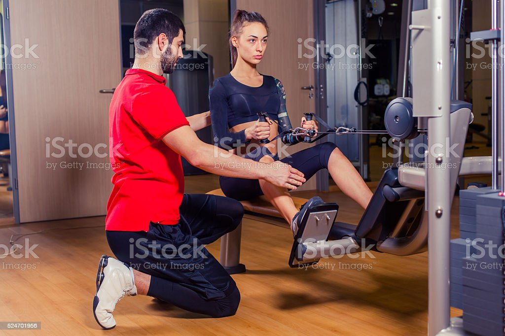 e35bcfc8b3c Personal Trainer Working With His Client In Gym Stock Photo   More ...