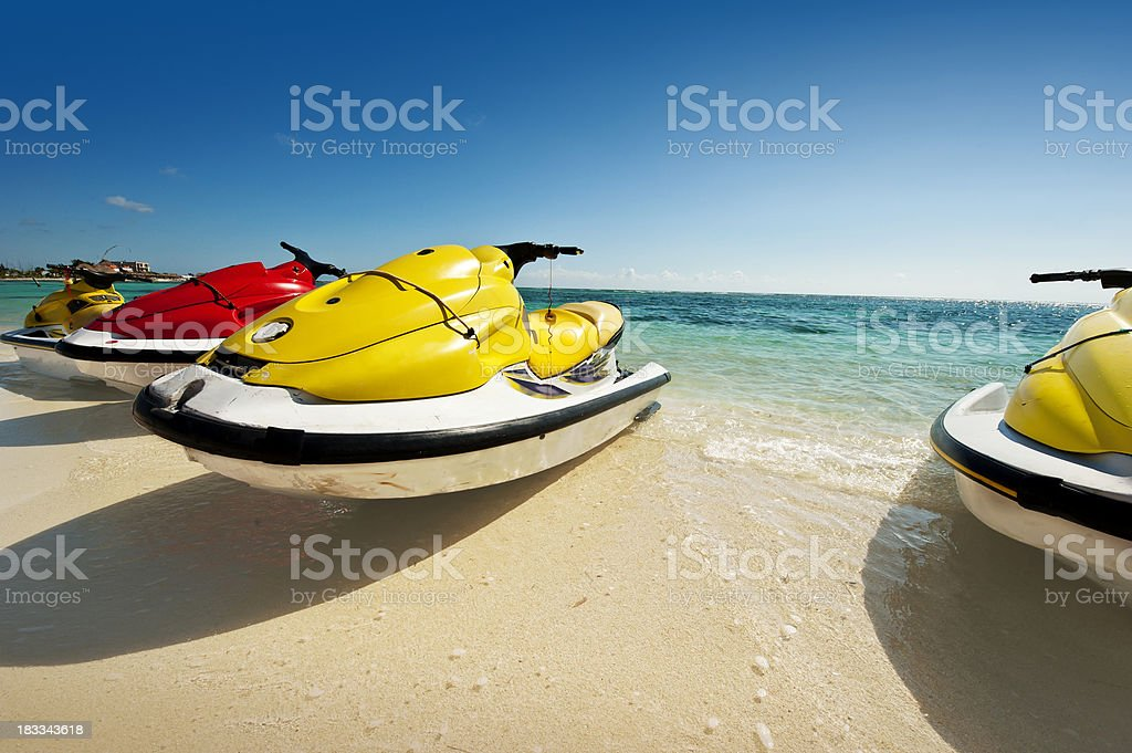 personal water craft on the beach stock photo