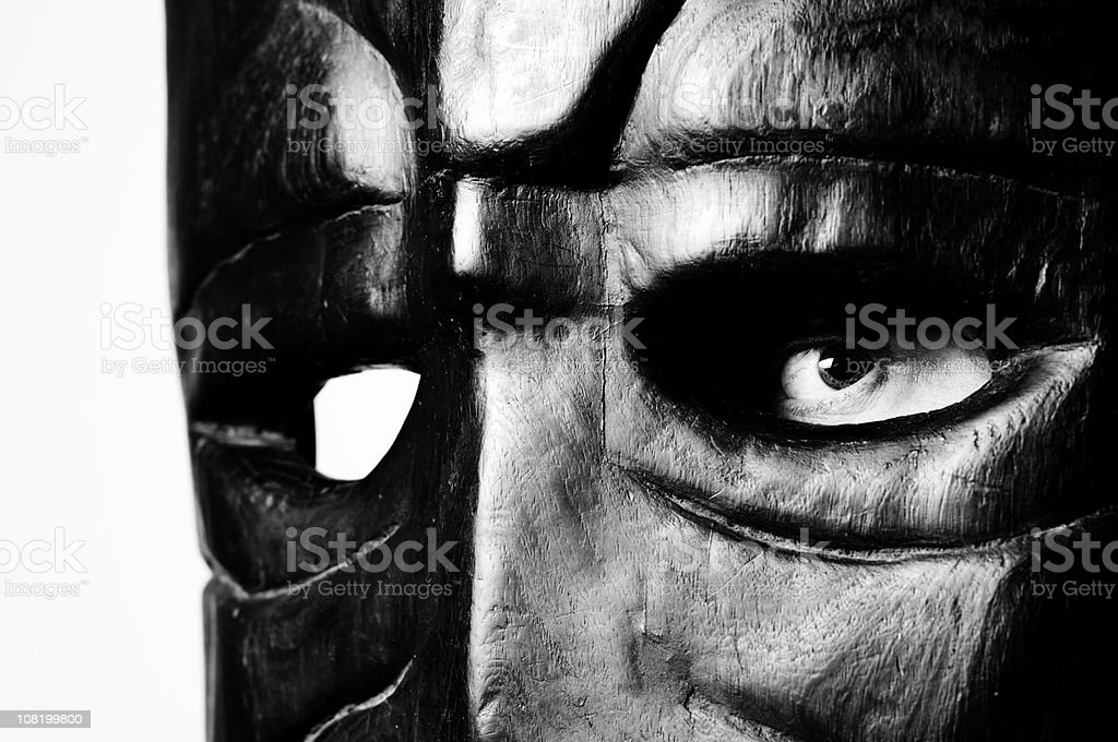 Person's Eye Behind Wooden Mask, Black and White stock photo