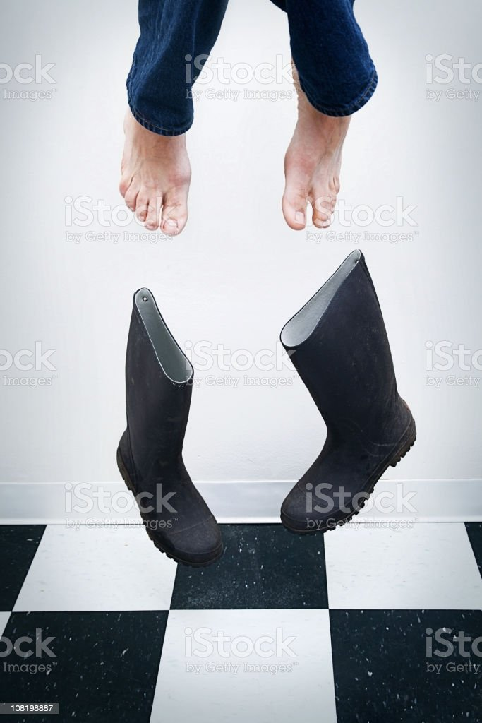 Person's Feet Flying Out Of Their Boots royalty-free stock photo