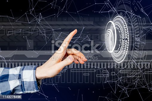 istock persons hand and 3d finger print hologram in front of him b 1143278496