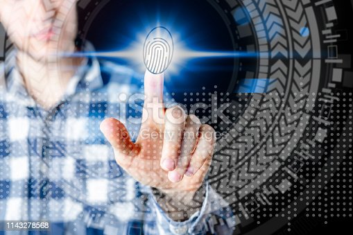 istock persons hand and 3d finger print hologram in front of him b 1143278568