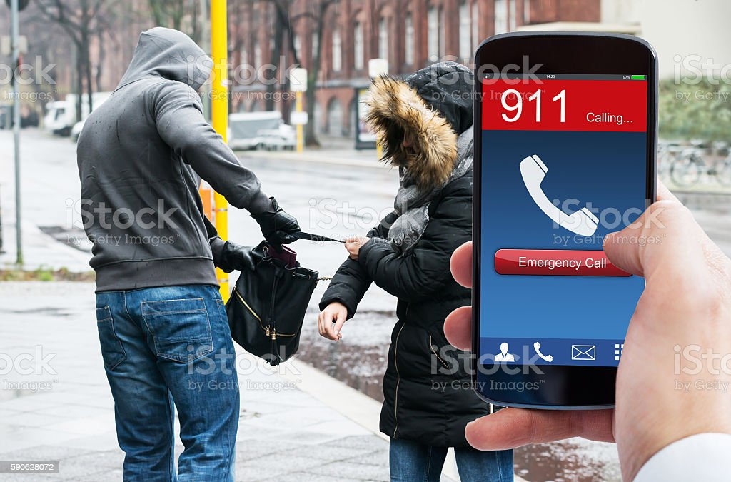Person's Hand Dialing Emergency Call On Mobile Phone stock photo
