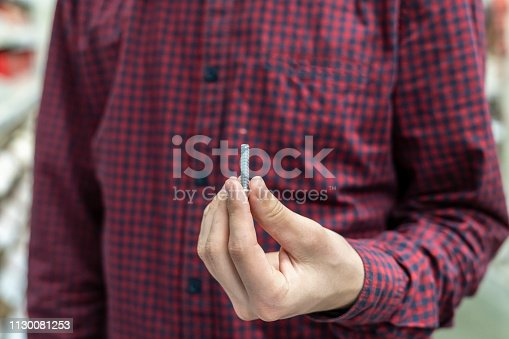 istock persons hand hold silver bolts close up concept b 1130081253