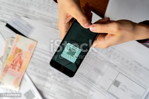 istock persons hand hold spartphone scanning qr code b 1130990890