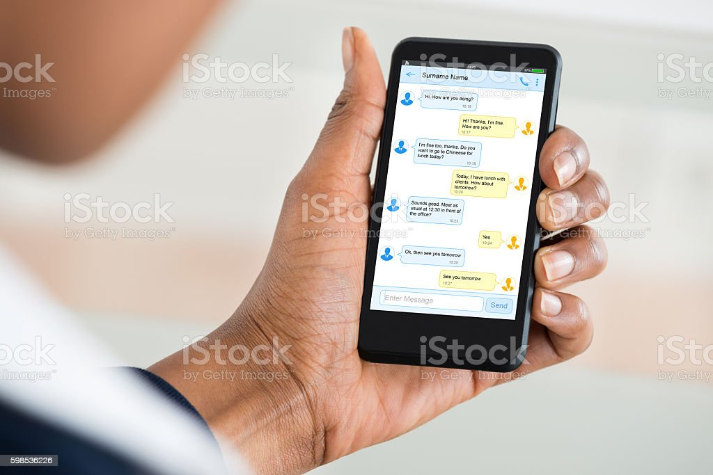 Person's Hand Holding Mobile Phone stock photo