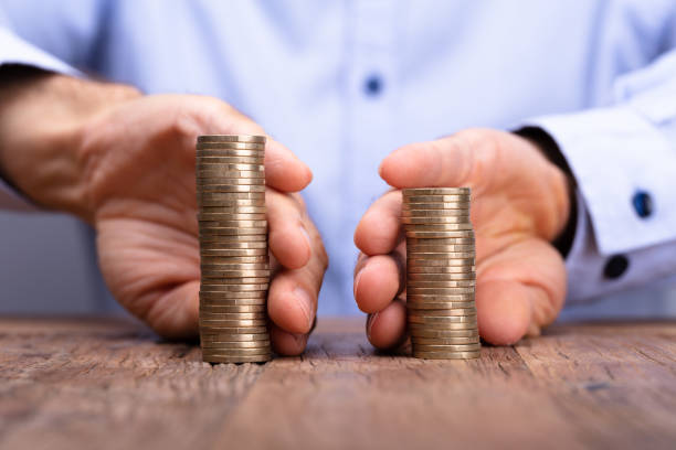 person's hand holding stack of coins - disconnect stock pictures, royalty-free photos & images