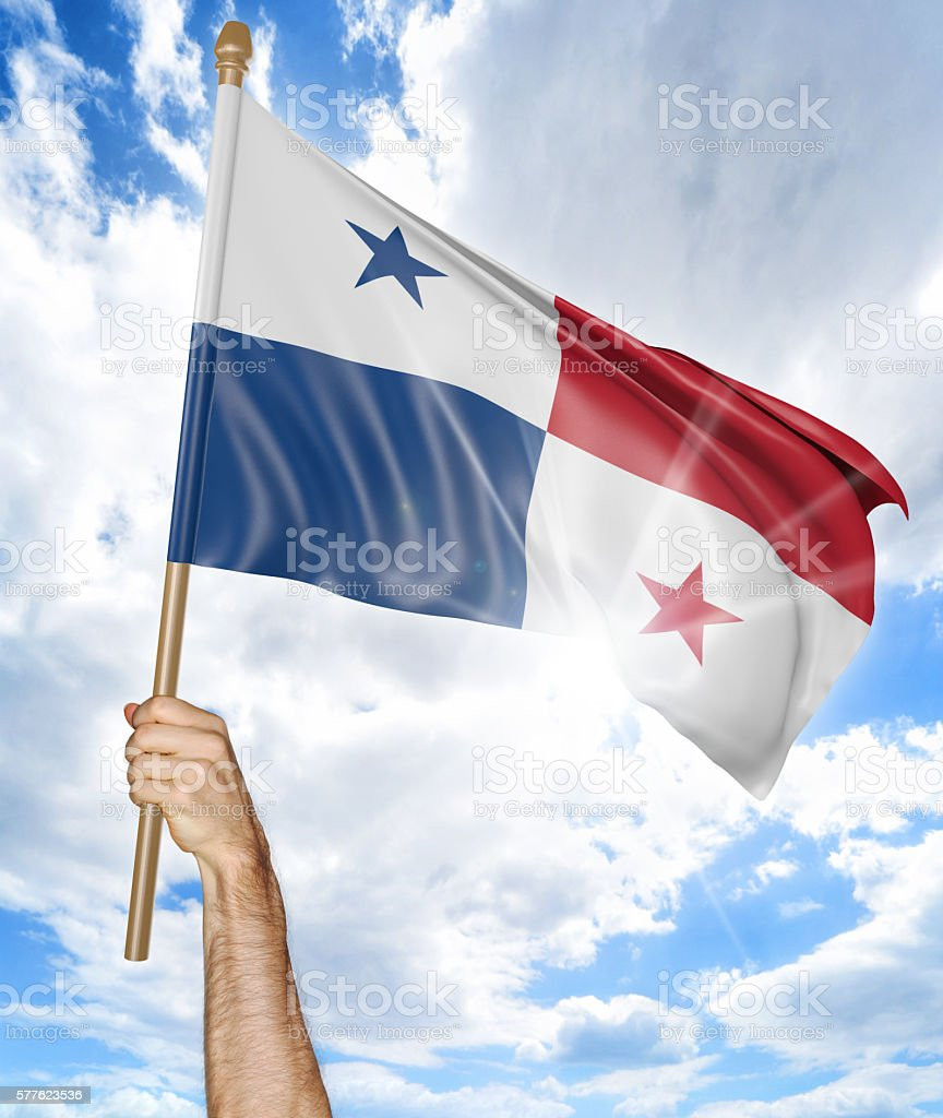 Person's hand holding the Panamanian national flag and waving it stock photo