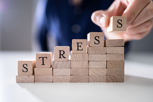 istock Person's Hand Placing Last Alphabet Of Word Stress 1191082102