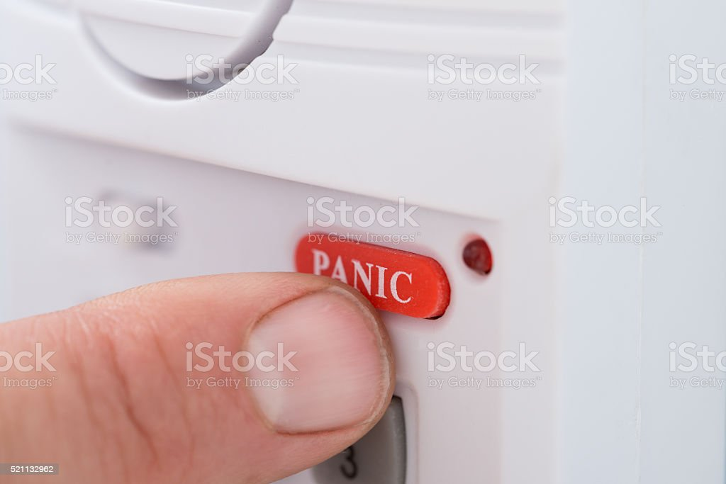 Person's Hand Pressing Panic Button stock photo